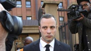 Oscar Pistorius leaves the high court in Pretoria, South Africa, on 20 May 2014.