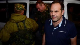 One of the OSCE observers detained by pro-Russian separatists gets out of a vehicle in Donetsk after the group's release - 28 June 2014