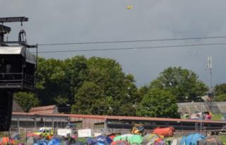 Air ambulance flying over Glastonbury festival site