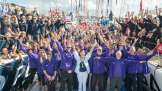 The Clipper teams were led to their yachts by the city's mayor Brenda Stevenson