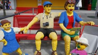 Lego family on bench