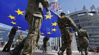 Soldiers of the Eurocorps hold the European flag during a ceremony in front of the European Parliament in Strasbourg, 30 June 2014