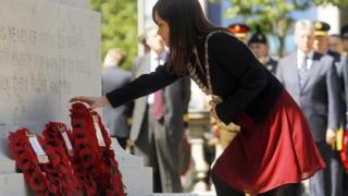 Lord Mayor Nichola Mallon lays a wreath