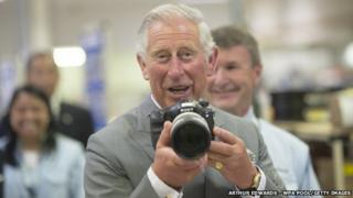 Prince Charles with a camera
