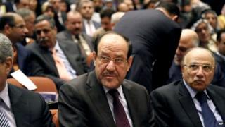 Iraqi PM Nouri al-Maliki, centre, attends the first session of parliament in the heavily fortified Green Zone in Baghdad, Iraq on 1 July 2014