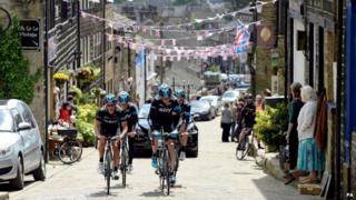 Chris Froome and Richie Porte cycling through Haworth
