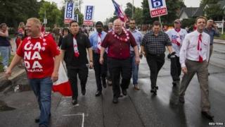 Toronto Mayor Rob Ford (C) and his brother Doug (L) take part in the East York Canada Day Parade in the mayor's first public appearance since returning from a rehabilitation clinic for substance abuse problems in Toronto 1 July 2014
