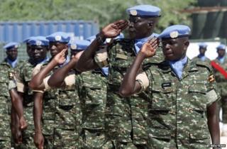 Amisom troops salute at Mogadishu airport, 18 May