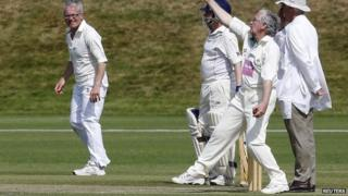 Sir Mervyn King bowling at the Bank of England's annual cricket match