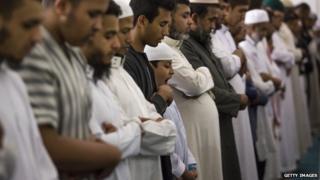 Men praying at East London mosque