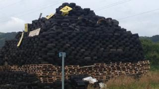A posters of Alliance MLA Anna was placed on a bonfire in Carrickfergus