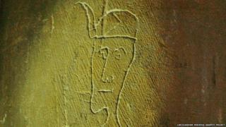 Head of a man etched into wall of a church in Lincolnshire