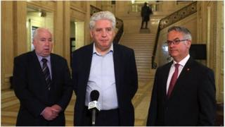 Joe Byrne, Alasdair McDonnell and Alex Attwood pictured at Stormont