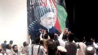 Putting up Abdullah Abdullah picture in rally