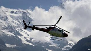 File photo: A helicopter of the Zurich-based helicopter company, Rega (Swiss Air-Rescue) lands at the air rescue base of Lauterbrunnen in the Bernese Oberland region of central Switzerland, 12 July 2007