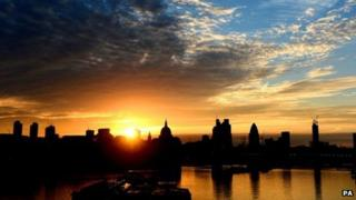 The sun rises over St Paul's Cathedral