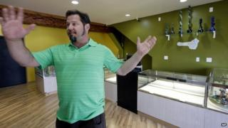 Cannabis City owner James Lathrop gestures as he stands in the middle of his new marijuana shop days before the grand opening in Seattle 2 July 2014
