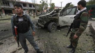 Afghan security forces investigate at the site of a bomb attack in Kabul on 6 June 2014.