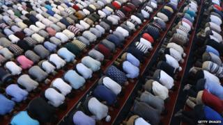 Many Muslim men knelt down in prayer