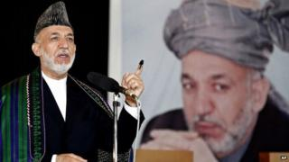 Afghan President Hamid Karzai speaks after casting his vote at a polling station in Kabul, Afghanistan, Saturday, June 14, 2014.