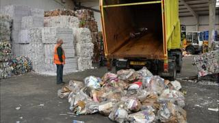 Recyclables being delivered for sorting and bailing before being shipped off island