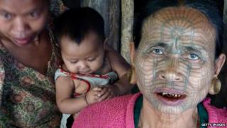 Tattooed woman in Myanmar
