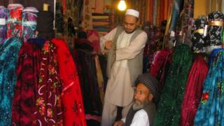 Customers have dwindled in Ghulam Sakhi's textile shop