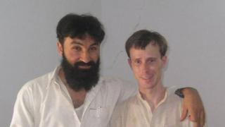 An undated, unverified photo of Sgt Bowe Bergdahl with what appears to be Badruddin Haqqani