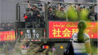 This picture taken on 6 June 2014 shows security forces participating in a military drill in Hetian, northwest China's Xinjiang region.