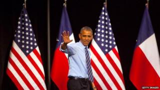 President Obama waves from the stage at a speech in Austin, Texas on 10 July