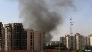 Smoke rises above Tripoli (13 July 2014)