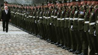 President Michael D Higgins inspects a Guard of Honour during an interfaith service of commemoration at the Royal Hospital Kilmainham.