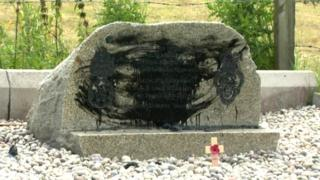 Paint on memorial to murdered soldiers