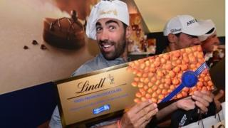 man with Lindt bar