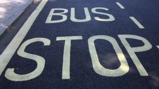 Bus Stop sign on road