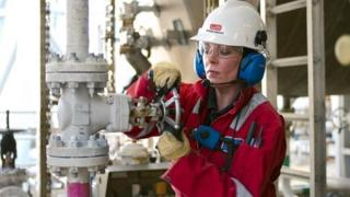 A Wood Group PSN production technician working on an offshore platform in the North Sea