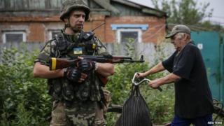 Ukraine military plane shot down as fighting rages