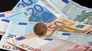 Euro notes and one euro coin