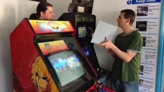 Volunteers working on arcade games