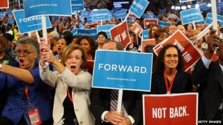 Supporters hold up signs at the Democratic National Convention in 2012.