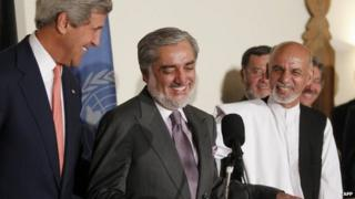 US Secretary of State John Kerry (L) and Afghan presidential candidates Abdullah Abdullah (C) and Ashraf Ghani (R) smile as they speak at a press conference announcing an audit of the votes