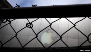 Apple logo behind fence