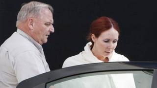 Shannon Richardson escorted to car