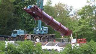 """The """"Archimedean screw"""" is lowered into place"""