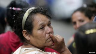 Relatives and friends wait for news of their children outside the home in the western city of Zamora on 16 July, 2014