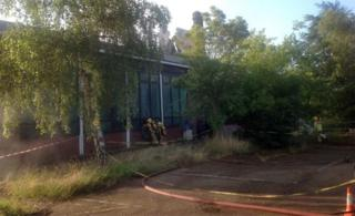 Firefighters checking for hot-spots at Pinebanks Centre