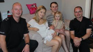 PC Andrew Masterson, Holly Mackie holding baby Rupert, Andrew Mackie holding Rose and PC Jerry Cohen
