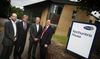 Atom's Edward Twiddy, chief innovation officer, left, with George Garlick, chief executive at Durham County Council, Anthony Thomson, chairman of Atom, and Councillor Simon Henig, leader of Durham County Council