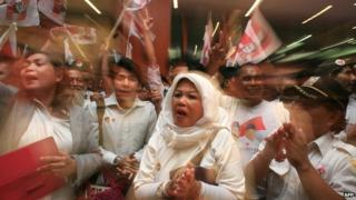 Supporters of Indonesian presidential candidate Prabowo Subianto gather inside a convention center in Jakarta after the close of polls on 9 July, 2014