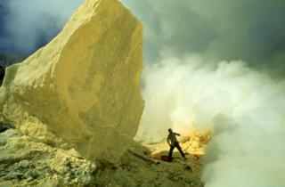 Sulphur fumes emanating from a crater in an active volcano on Java, Indonesia